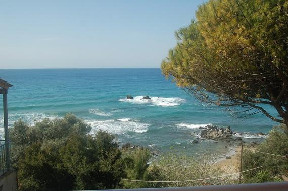 'Pelekas beach - view from our room's balcony at Sun Rock hostel' - Corfu